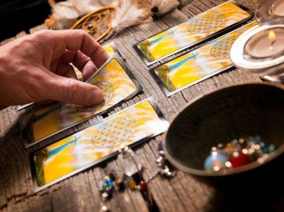 Fortune teller holding a tarot card
